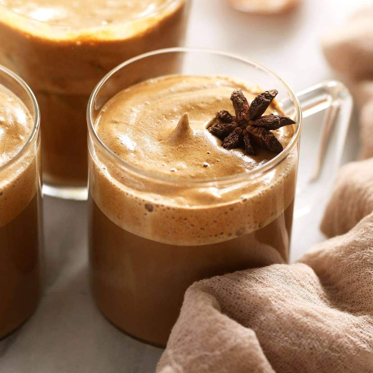 Pumpkin spice dalgona coffee in a cup.