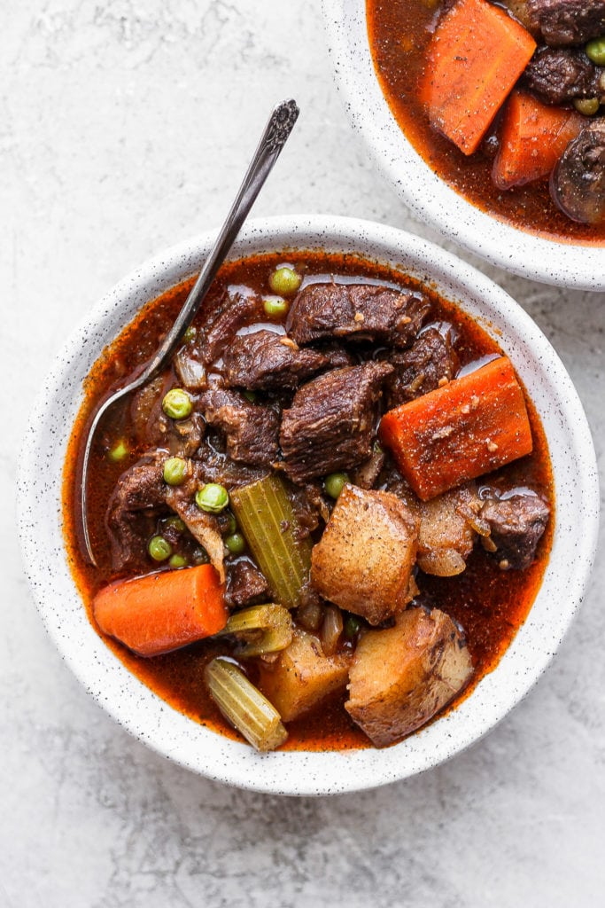 instant pot beef stew in a bowl with a spoon