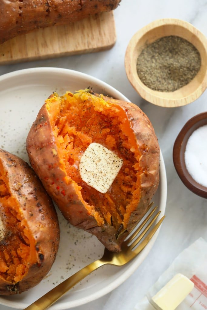 baked sweet potato recipe on plate with butter