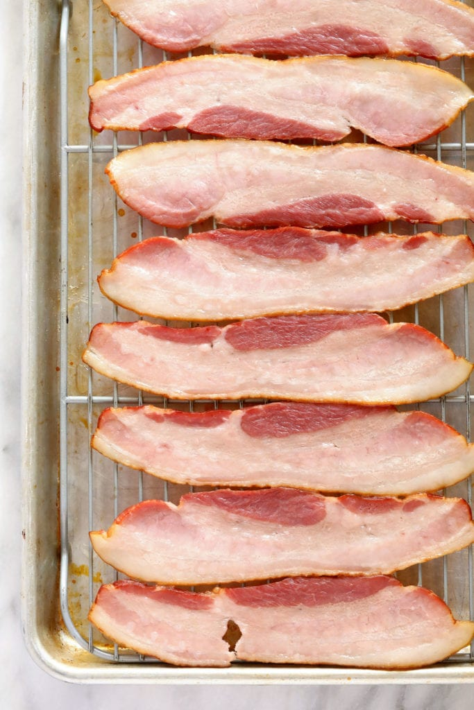 raw bacon ready to be baked