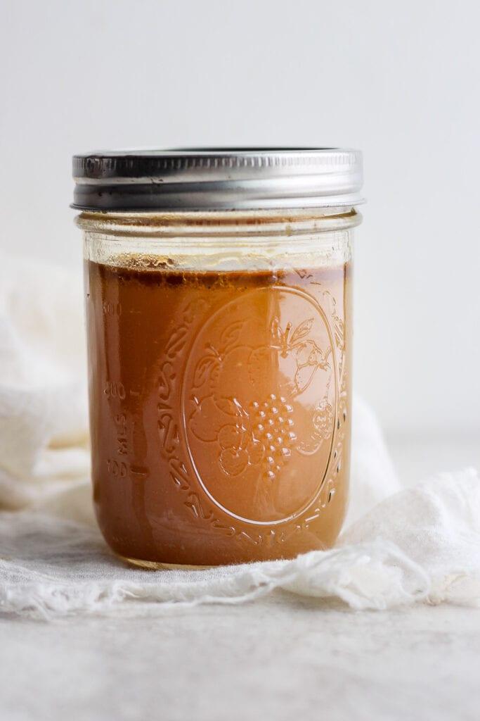Chicken broth in a mason jar.