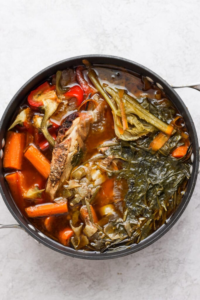 A pot of chicken and vegetables after simmering all day.