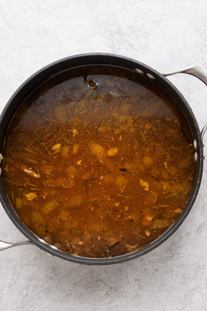 Chicken broth in a pot.