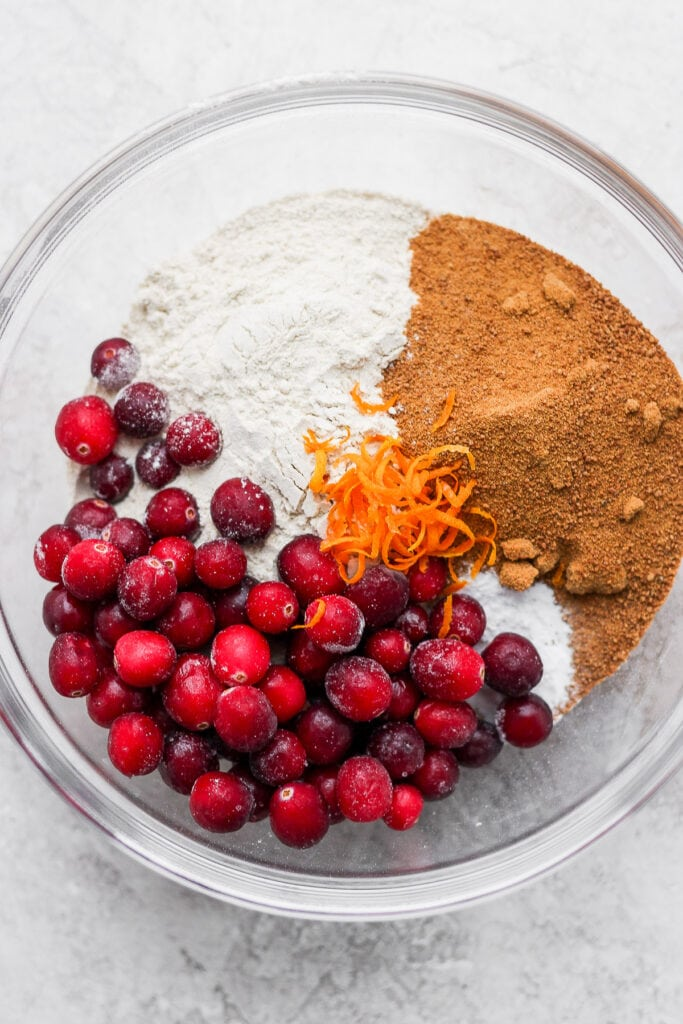 ingredients for cranberry orange muffins on a bowl, ready to be mixed