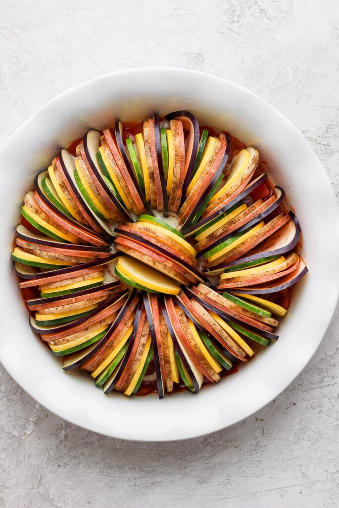 Vegetables for ratatouille in a baking dish.