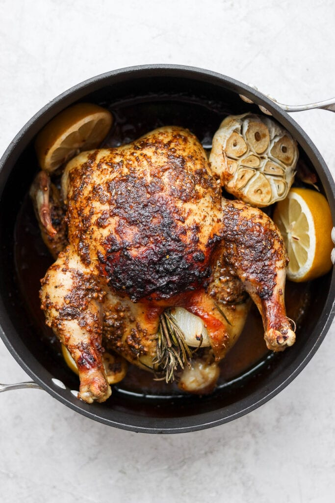 whole roasted chicken in pan