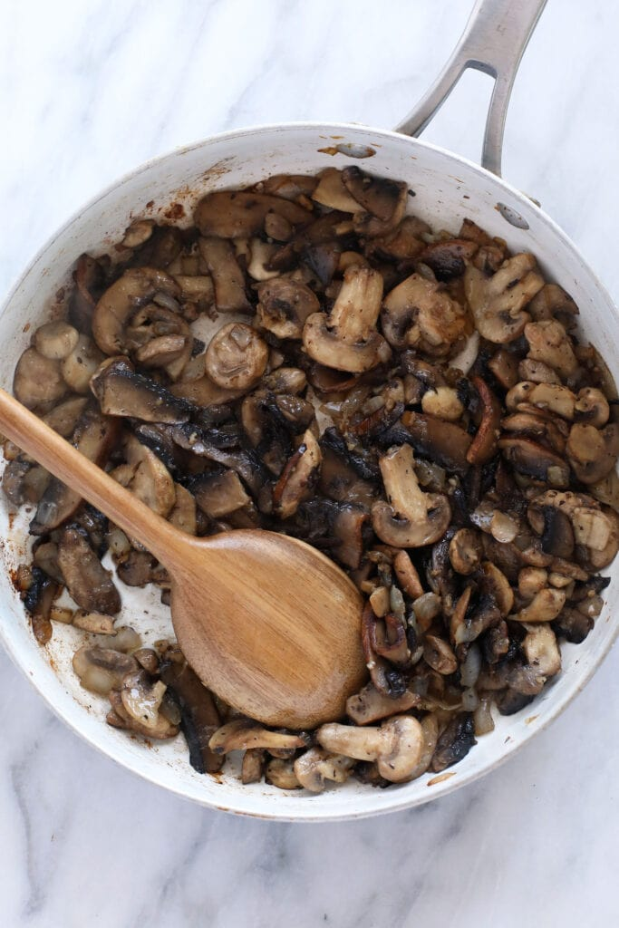 Sautéd mushrooms in a fry pan.