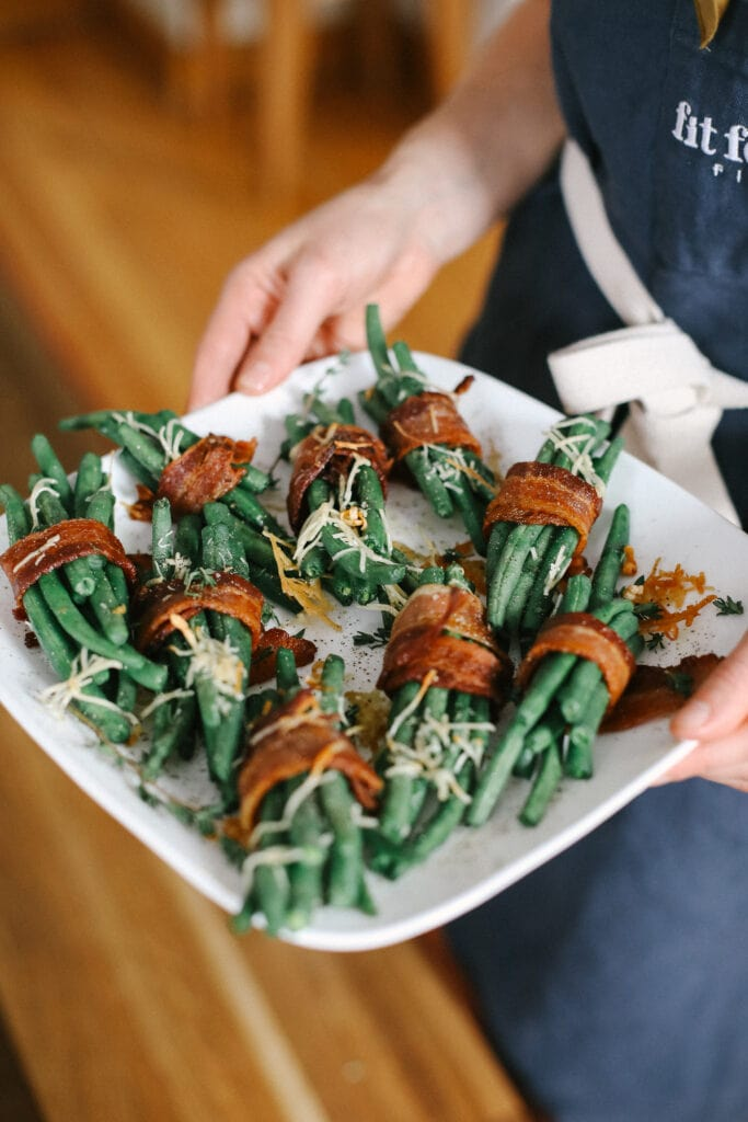 bacon wrapped green beans on a plate ready to be served