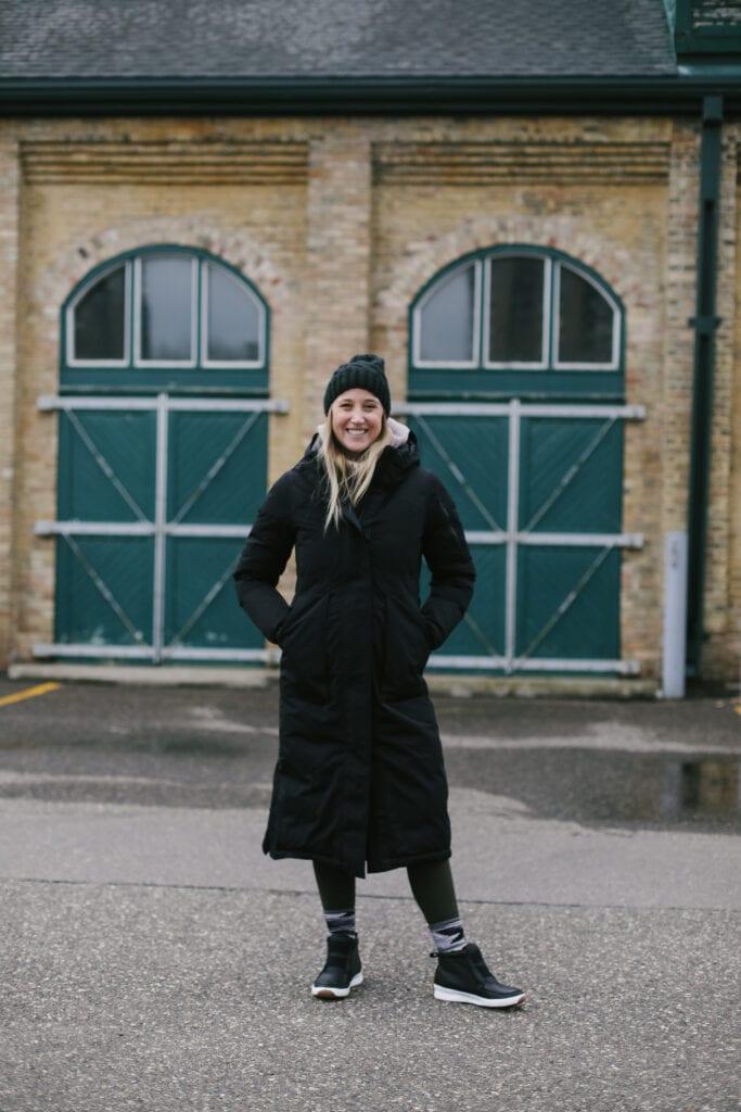 emily wearing a lululemon long winter jacket