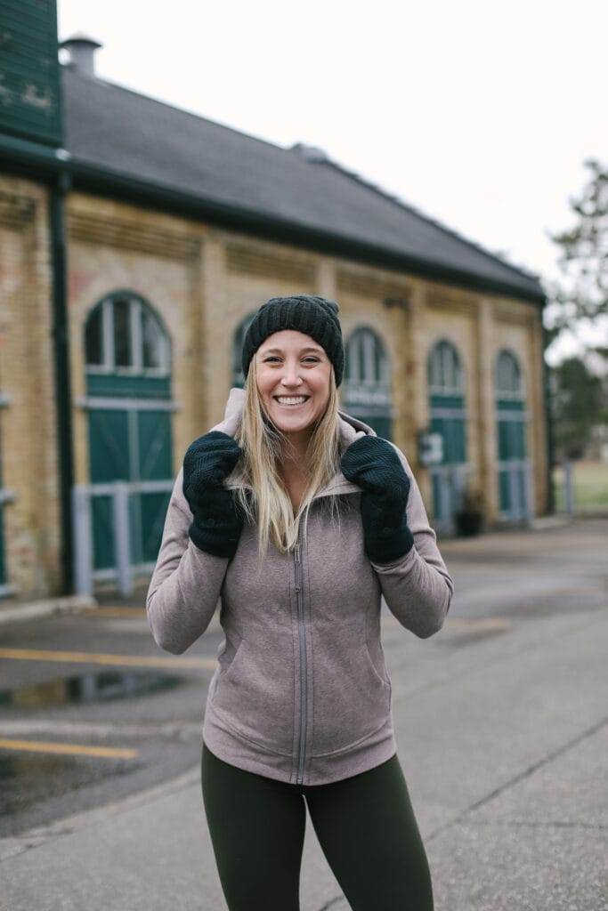 emily wearing a lululemon hoodie and mittens