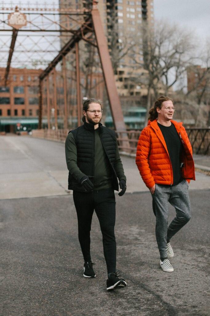 fit foodie husbands walking across a bridge in lululemon gear