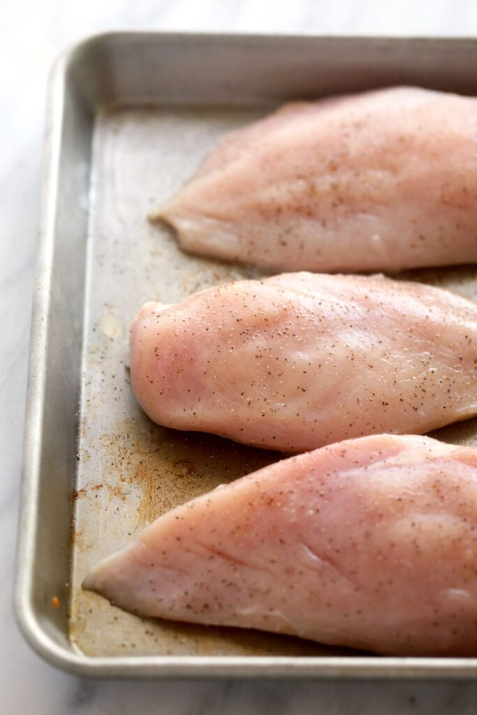 raw chicken breasts ready to be baked and then shredded
