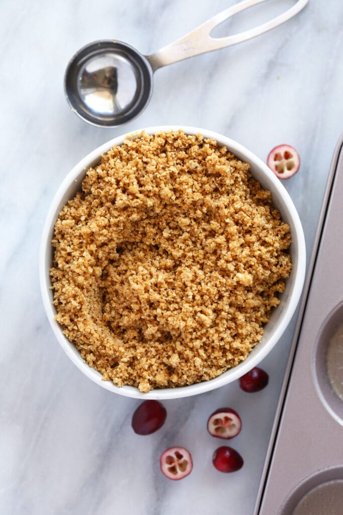 A bowl of graham cracker crumble before it's made into crush.