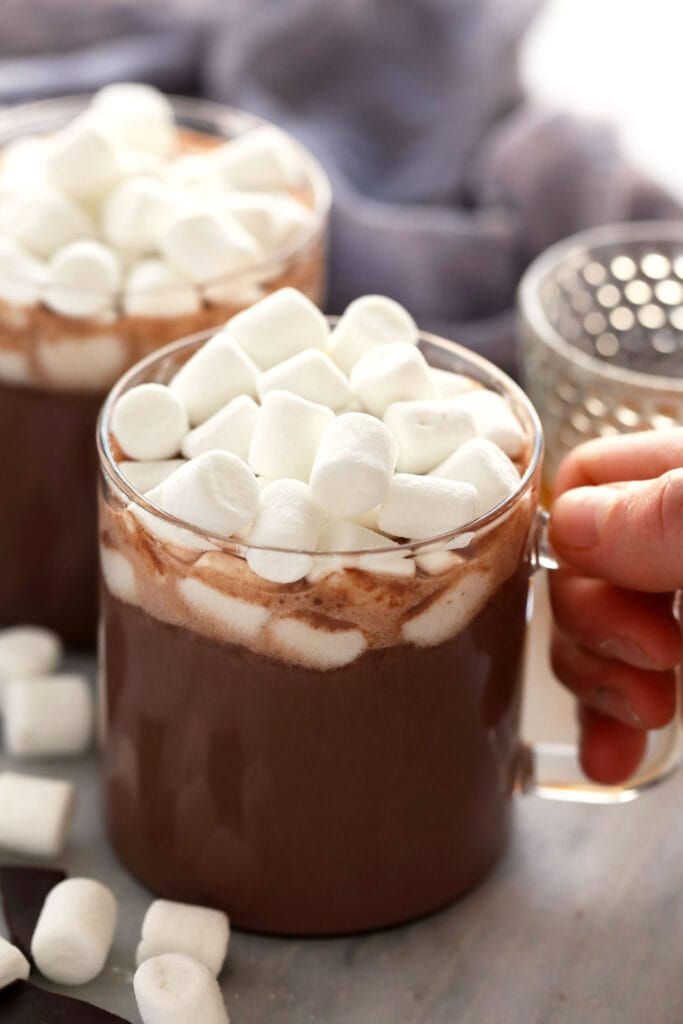 spiked hot chocolate in a mug topped with mini marshmallows