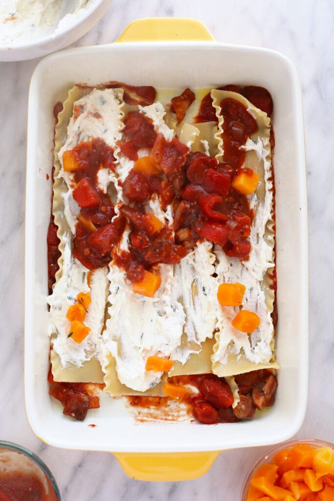 Building a butternut squash lasagna in a 9x13 pan.