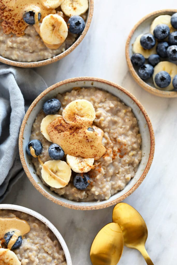 steel cut oats in bowl with banana and peanut butter