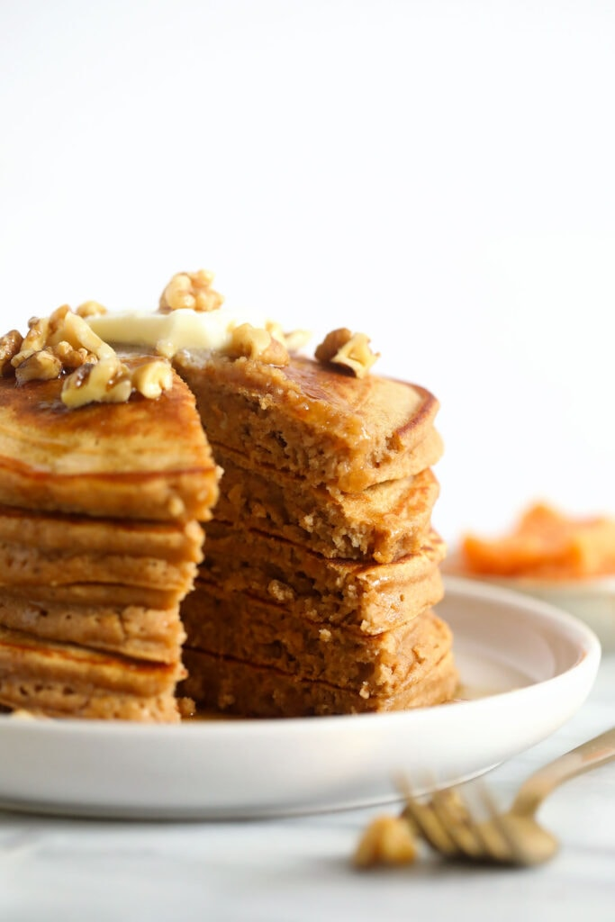 A stack of sweet potato pancakes on a plate.
