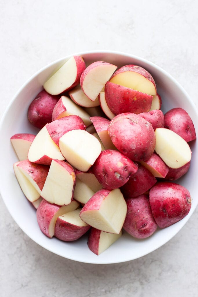sliced red potatoes ready to be tossed in ranch and roasted