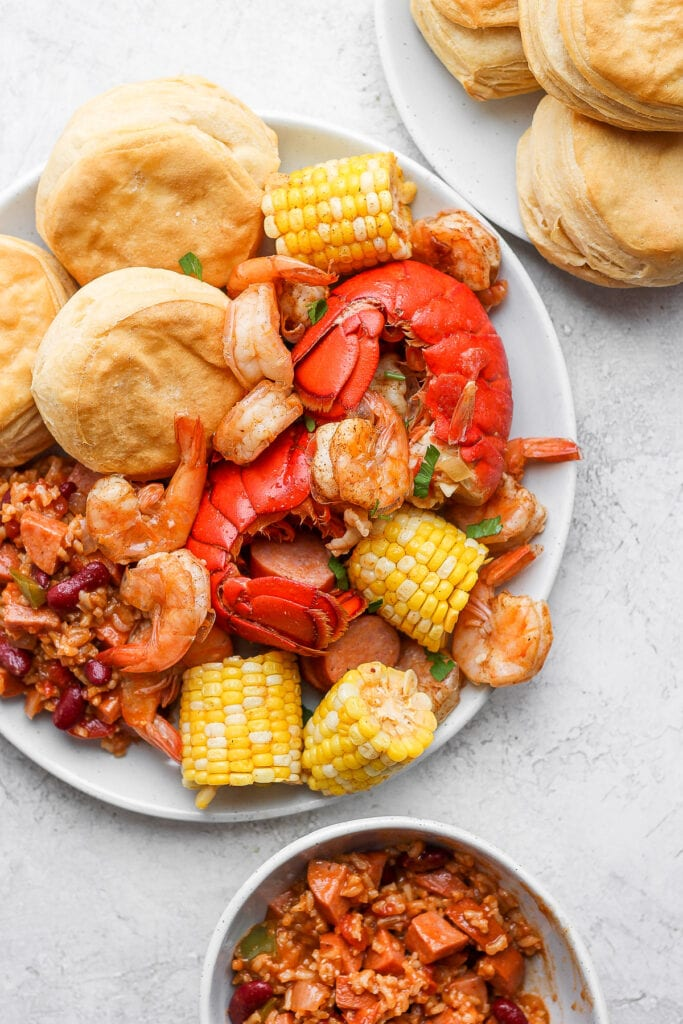 easy seafood boil on a plate with rice and beans and biscuits