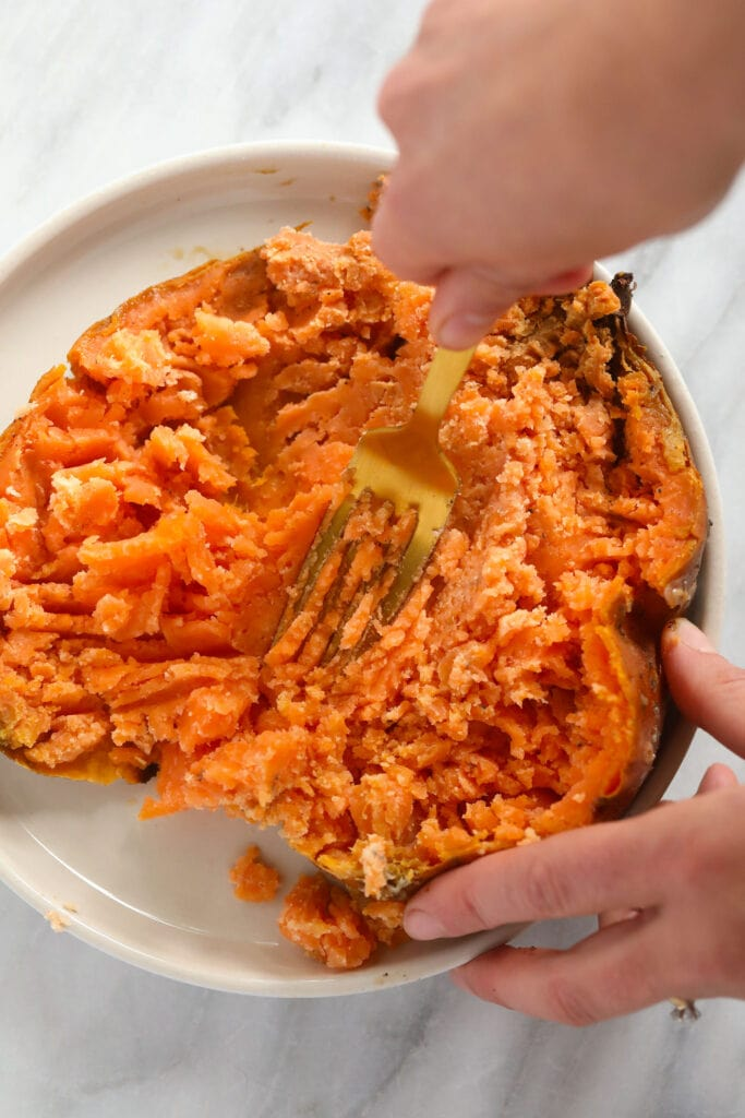 Making sweet potato puree out of a baked sweet potato.