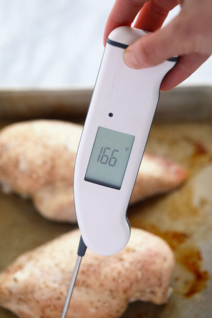 thermometer in a chicken breast to determine internal temperature