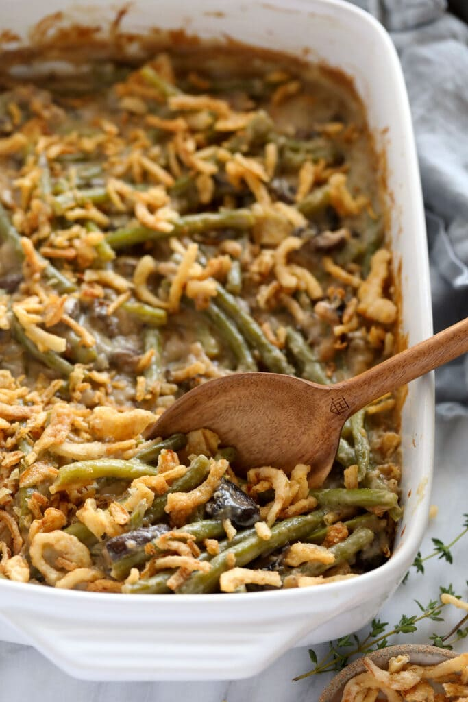 casserole with onions and a spoon