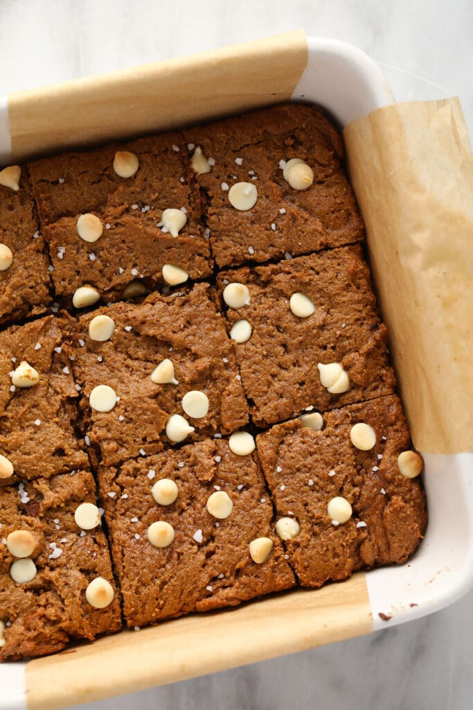 gingerbread cookie bars in a baking dish cut into square bars