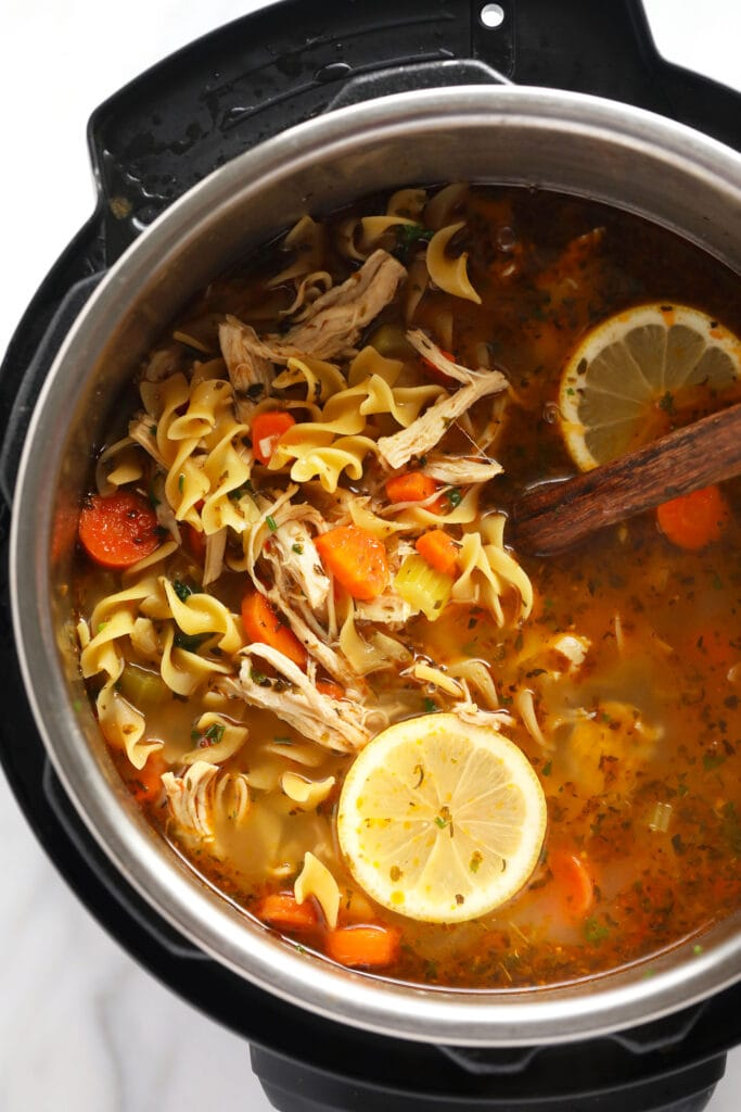 Instant Pot chicken noodle soup in IP with lemon wedge