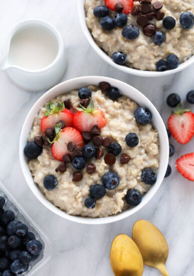 oatmeal in bowl with spoon and toppings