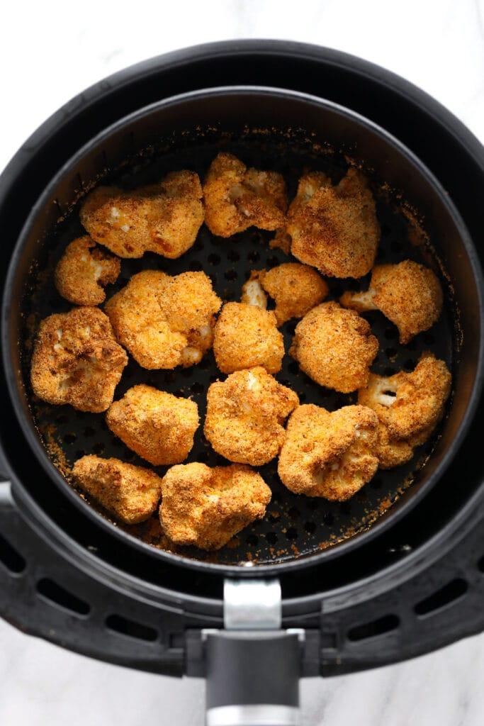 crunchy cauliflower in air fryer that is golden brown