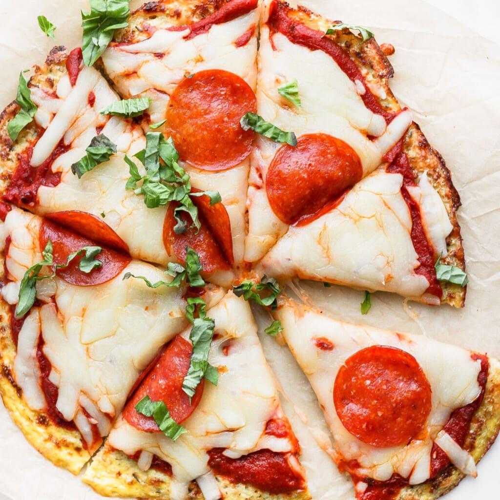 Cauliflower Pizza on a baking sheet