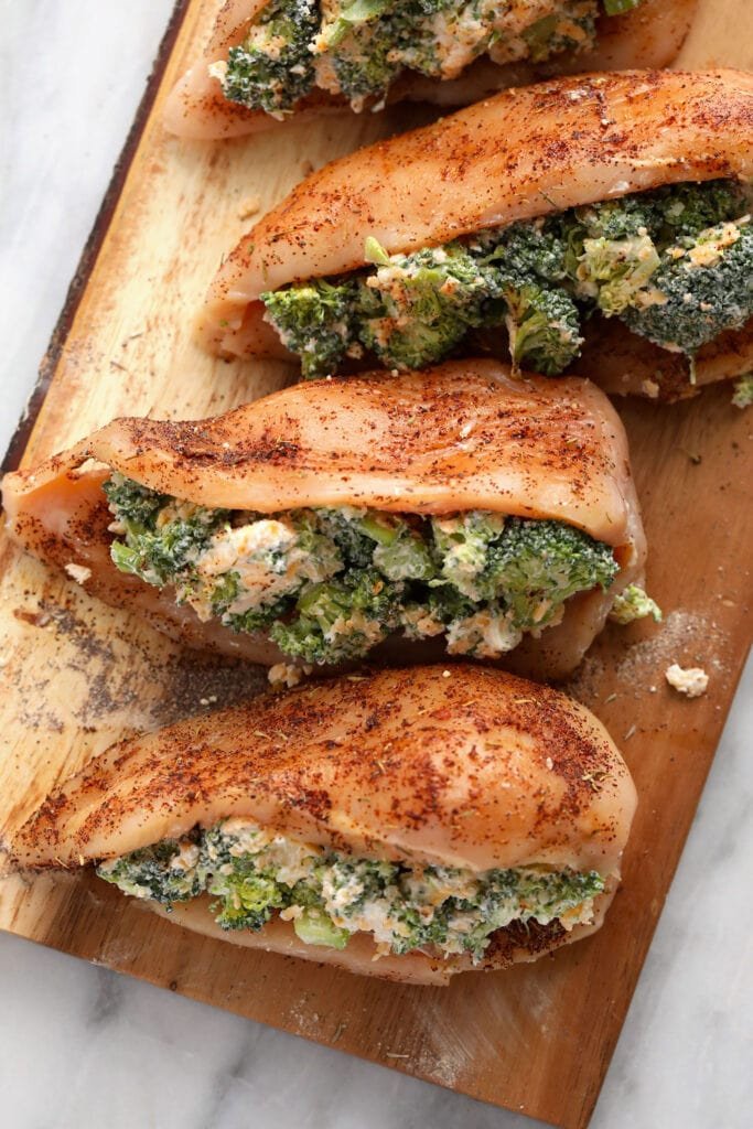 broccoli and cheese stuffed chicken breasts ready to be seared and then baked