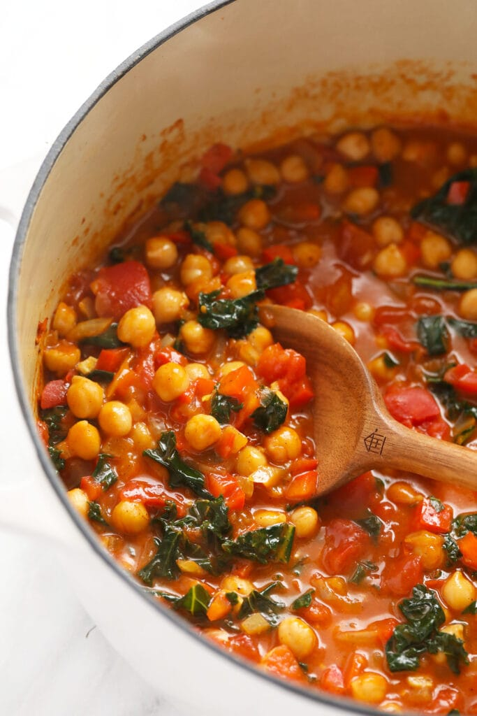 chickpea curry in a dutch oven ready to be spooned into
