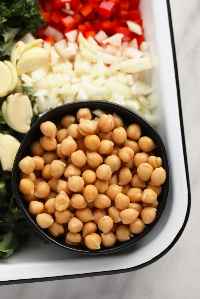 chickpeas in a bowl, ready to be added to chickpea curry