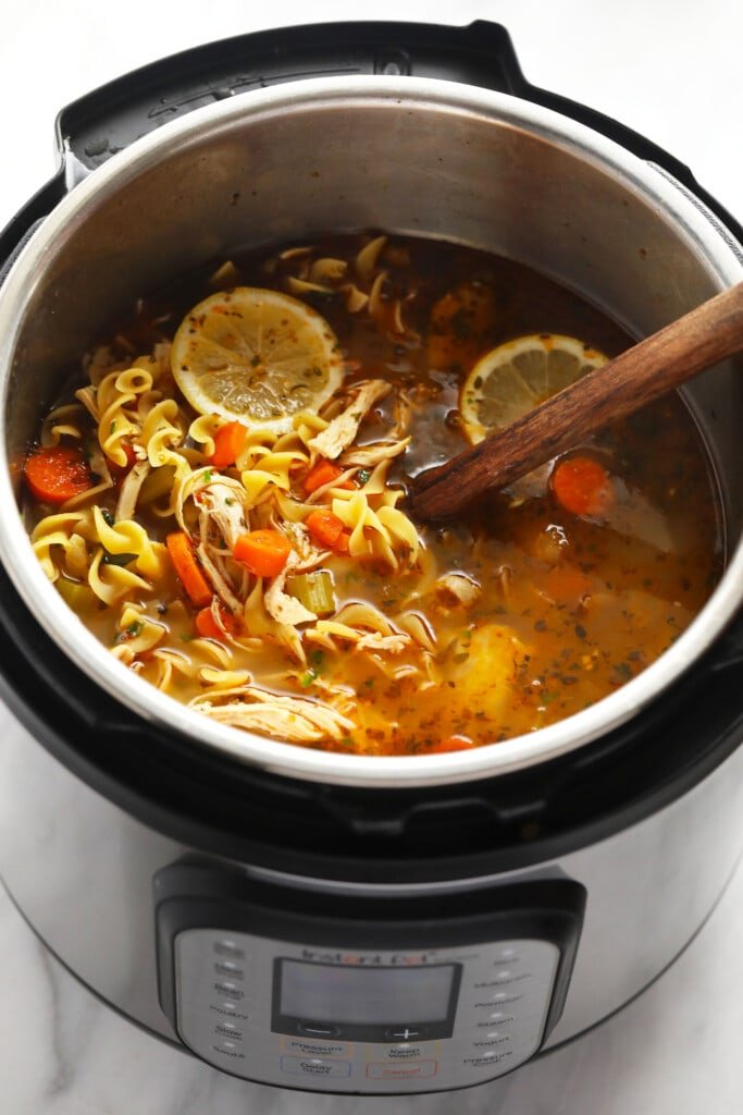 Instant Pot chicken Noodle Soup in Instant Pot with wooden spoon