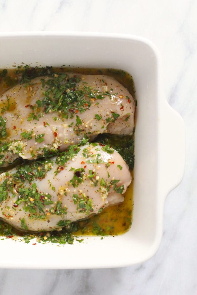 Marinating chicken in a pan.