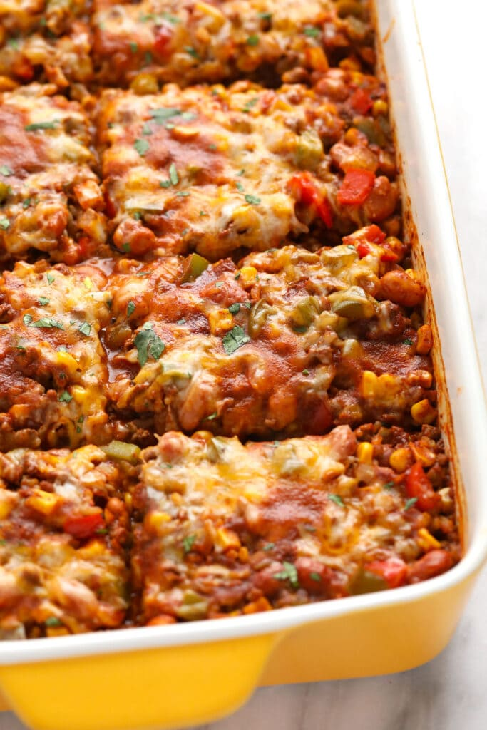 Baked Mexican casserole sliced into pieces.