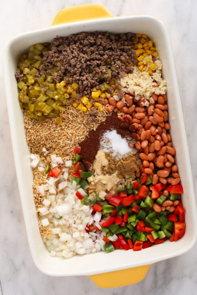 All the ingredients for an easy Mexican casserole in a casserole dish.