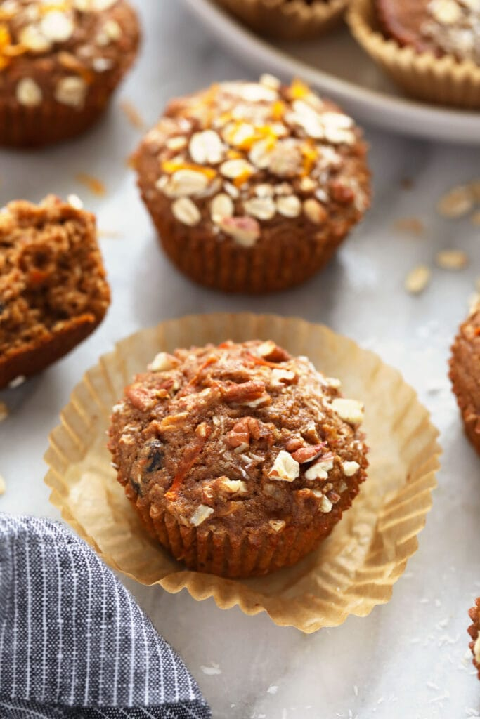 A morning glory muffin with fresh oats on top.