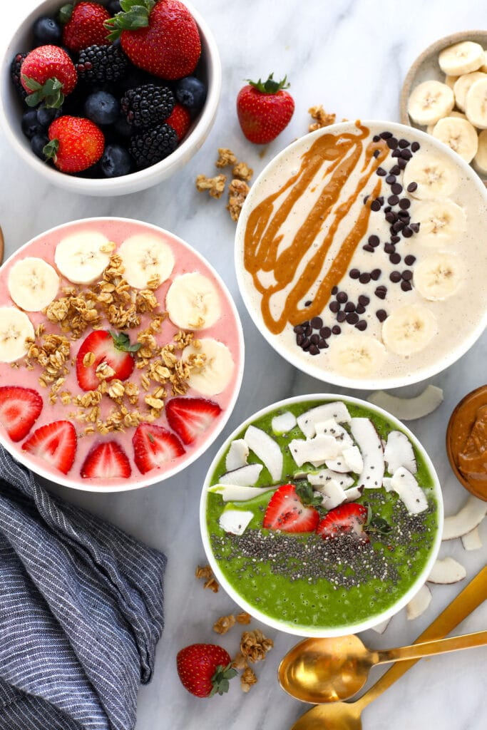 3 smoothie bowls with toppings