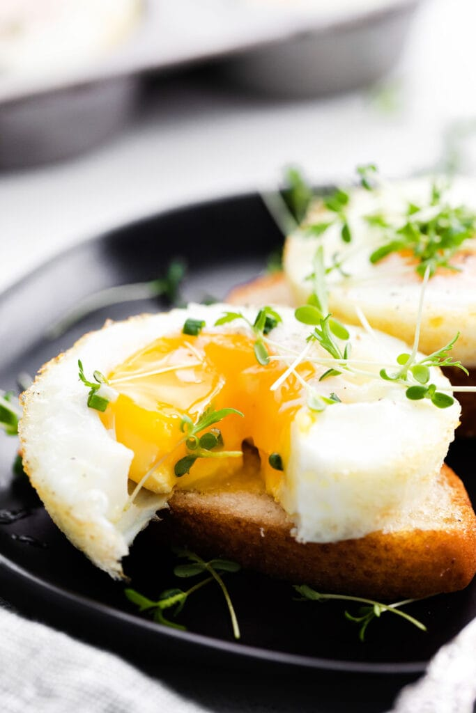 baked egg with runny yolk on bread
