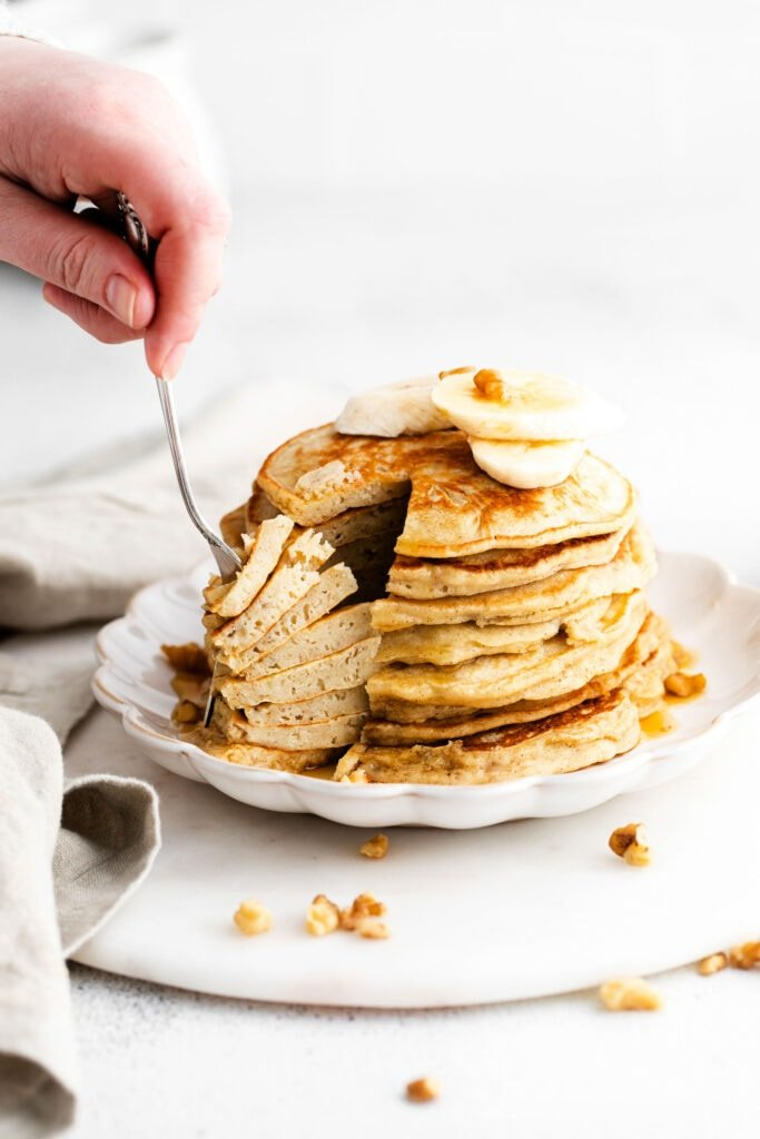 forking stack of pancakes