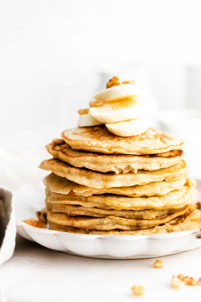 stack of pancakes with banana on top