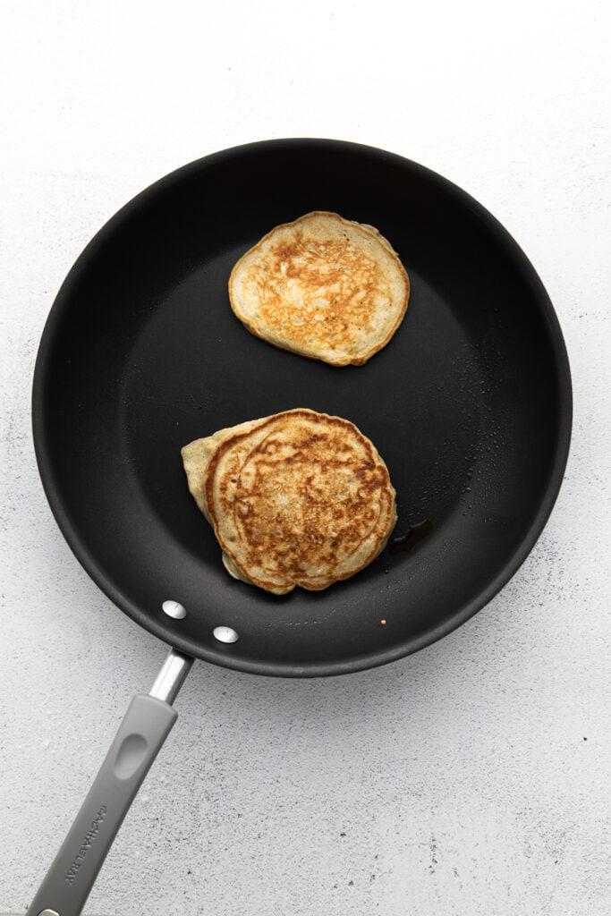 cooking pancakes in pan