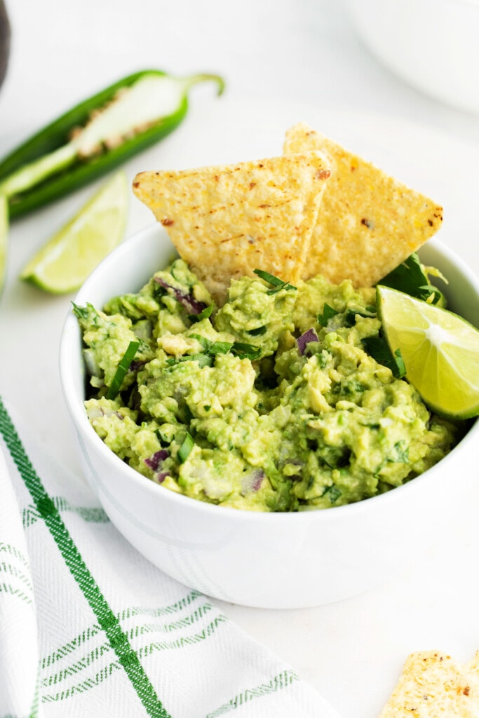Guacamole with tortilla chips in the guacamole.