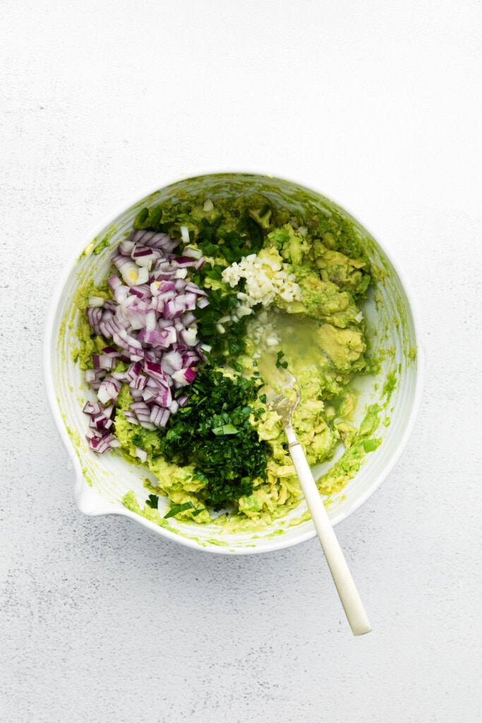 Guacamole ingredients in a bowl.