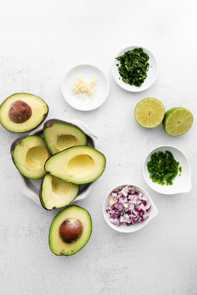Guacamole ingredients on a counter top.
