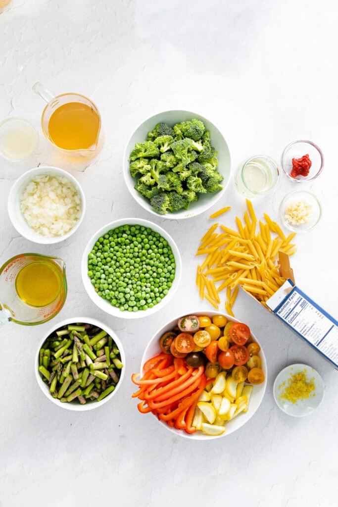 pasta primavera ingredients in bowls, ready to be prepared