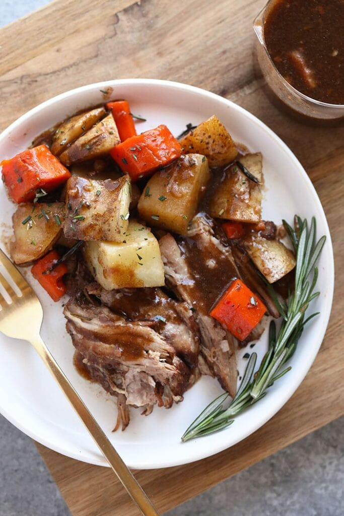 pork roast with veggies on plate