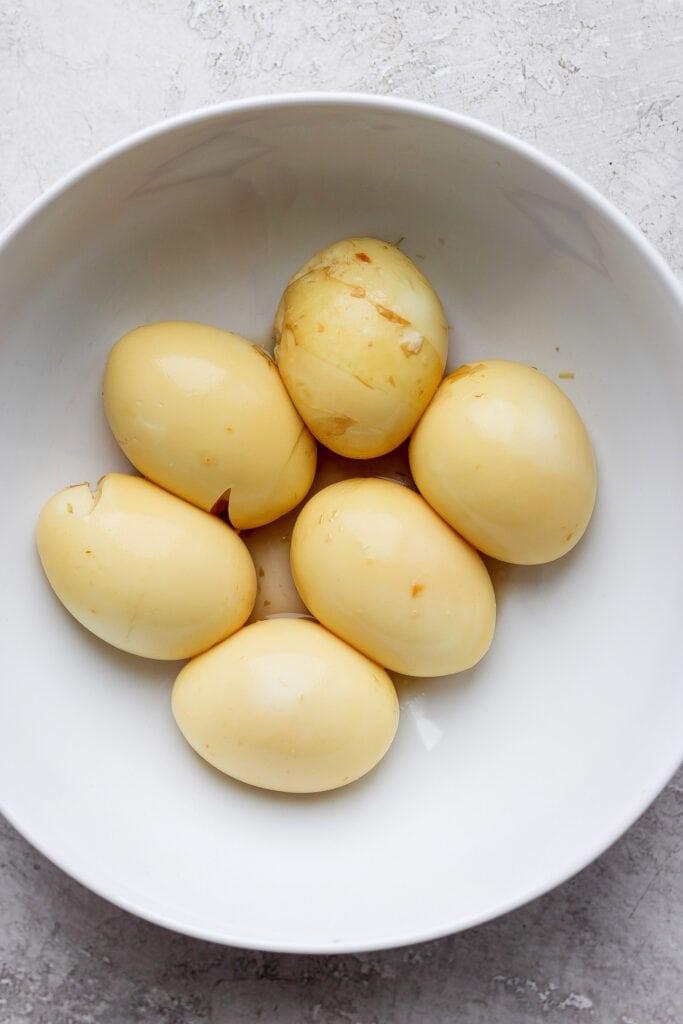 Marinated ramen eggs on a plate.